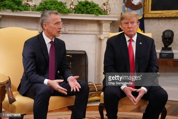 Secretary General Jens Stoltenberg and US President Donald Trump talk to reporters in the Oval Office at the White House April 02 2019 in Washington...