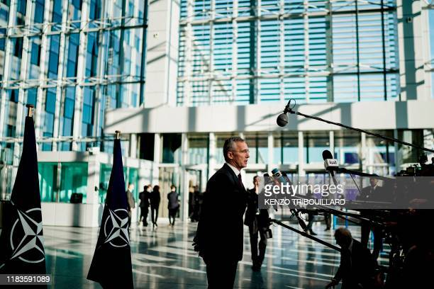 Secretary General Jens Stoltenberg answers journalists' questions as he arrives for a NATO Foreign Affairs ministers' summit at the NATO headquarters...