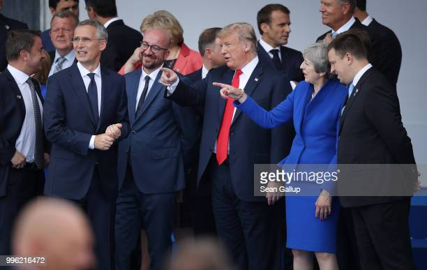 NATO Secretary General Jens Stoltenberg Belgian Prime Minister Charles Michel US President Donald Trump and British Prime Minister Theresa May attend...