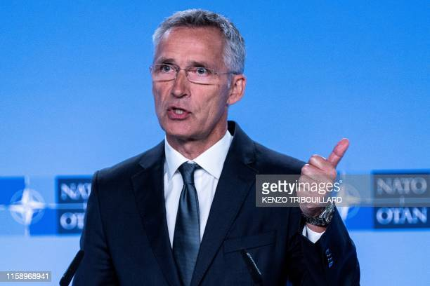 Secretary General Jens Stoltenberg gestures as he delivers a speech during a press conference about the end of the IntermediateRange Nuclear Forces...