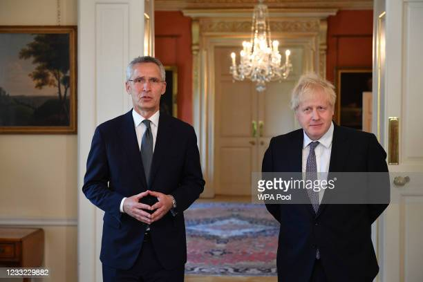 Secretary general Jens Stoltenberg gestures as he speaks next to Prime Minister Boris Johnson during a press conference following their meeting...