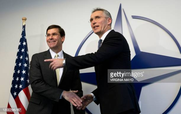 Secretary General Jens Stoltenberg greets US Secretary for Defense Mark Esper prior to a meeting at NATO headquarters in Brussels on February 12 2020...