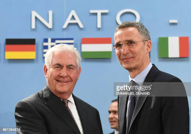 Secretary General Jens Stoltenberg greets US Secretary of State Rex Tillerson upon his arrival for a North Atlantic Council meeting at the level of...