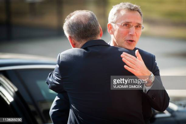Secretary General Jens Stoltenberg is welcomed by Slovakian President Andrej Kiska as he arrives at a summit of eastern NATO countries in Kosice...