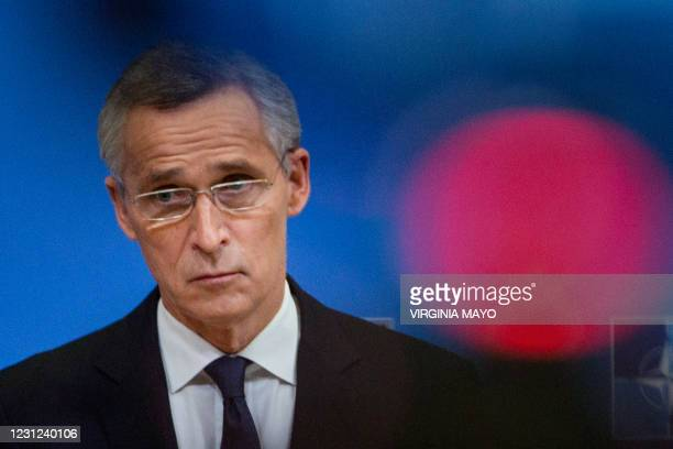 Secretary General Jens Stoltenberg looks on during a press conference following a video conference with NATO Defence Ministers, at the NATO...