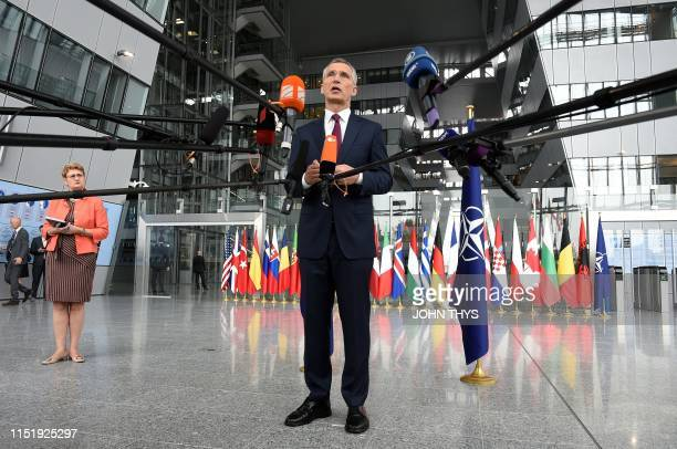 Secretary General Jens Stoltenberg make a statement to the press at the doorstep at the NATO headquarters during a Defence Ministers meeting in...