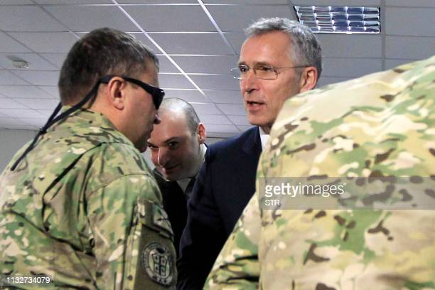 Secretary General Jens Stoltenberg meets with Georgian soldiers who were injured during a peacekeeping mission in Afghanistan as he attends a joint...