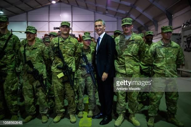 Secretary General Jens Stoltenberg poses with US Army soldiers as he visits the Italianrun military base Camp Arena to meet the soldiers in the...