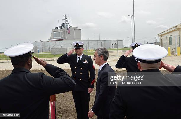 Secretary General Jens Stoltenberg reviews an honour guard during an inauguration ceremony of the US antimissile station Aegis Ashore Romania at the...