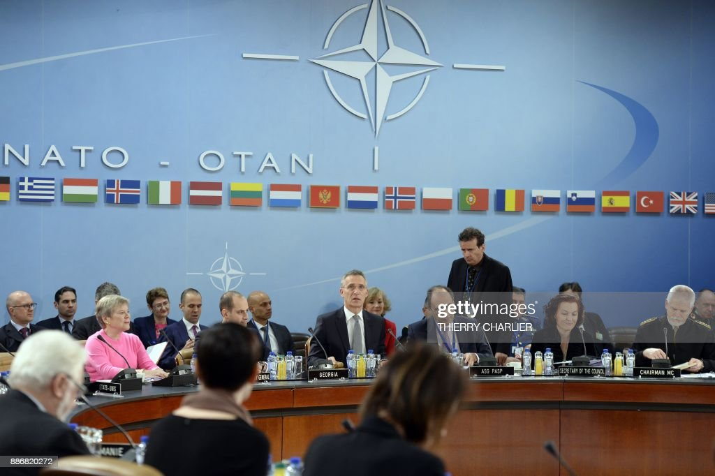 Secretary General Jens Stoltenberg (C) speaks during a NATO Foreign Affairs Ministers' meeting held at NATO headquarter in Brussels on December 6, 2017. /