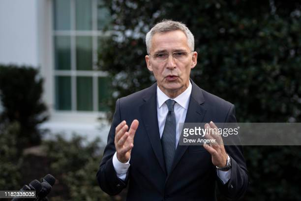 Secretary General Jens Stoltenberg speaks to reporters outside the West Wing of the White House following a meeting with US President Donald Trump on...