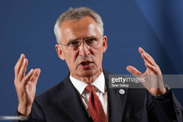 Secretary General Jens Stoltenberg speaks to the media upon his arrival at a meeting of European Union member states defence ministers on August 26,...