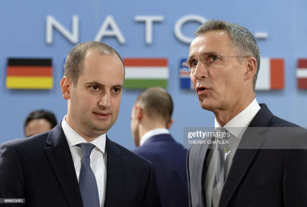 Secretary General Jens Stoltenberg (R) speaks with Georgia's Foreign Affairs Minister Mikheil Janelidze during a NATO Foreign Affairs Ministers' meeting held at NATO headquarter in Brussels on December 6, 2017. /