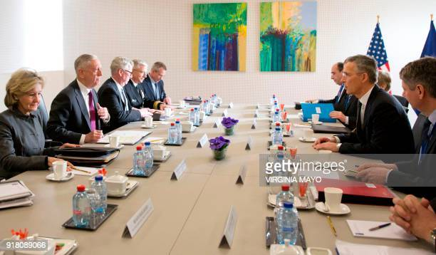 Secretary General Jens Stoltenberg speaks with US Secretary for Defense James Mattis during a meeting of the North Atlantic Council at the NATO...