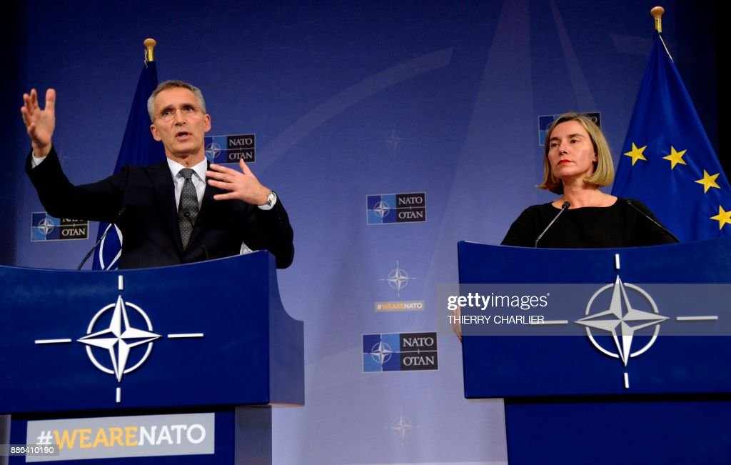 Secretary General Jens Stoltenberg (L) talks to the media with European Union High Representative for Foreign Affairs and Security Policy Federica Mogherini (R) during a NATO Foreign Affairs Ministers' meeting held at NATO headquarter in Brussels, on December 5, 2017. /