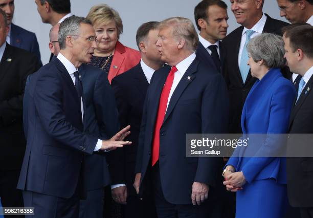 NATO Secretary General Jens Stoltenberg US President Donald Trump and British Prime Minister Theresa May attend the opening ceremony at the 2018 NATO...