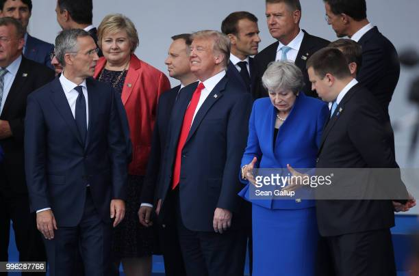 NATO Secretary General Jens Stoltenberg US Presidnt Donald Trump and British Prime Minister Theresa May attend the opening ceremony at the 2018 NATO...