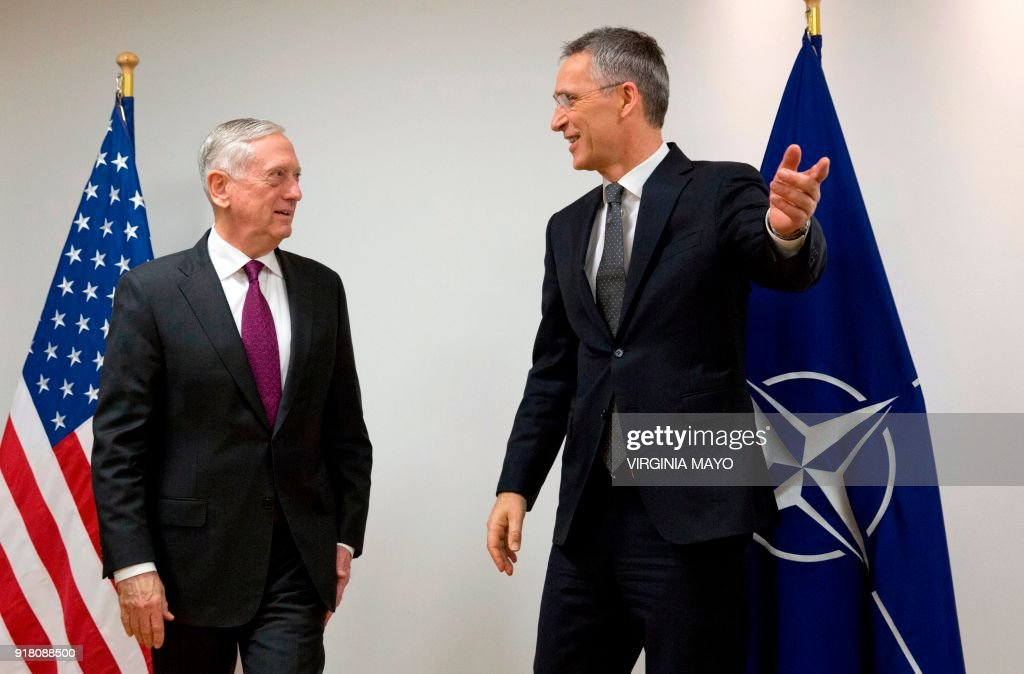 Secretary General Jens Stoltenberg (R) welcomes US Secretary for Defense James Mattis prior to a meeting of the North Atlantic Council (NAC) at the NATO headquarters in Brussels on February 14, 2018. / AFP PHOTO / POOL / Virginia Mayo