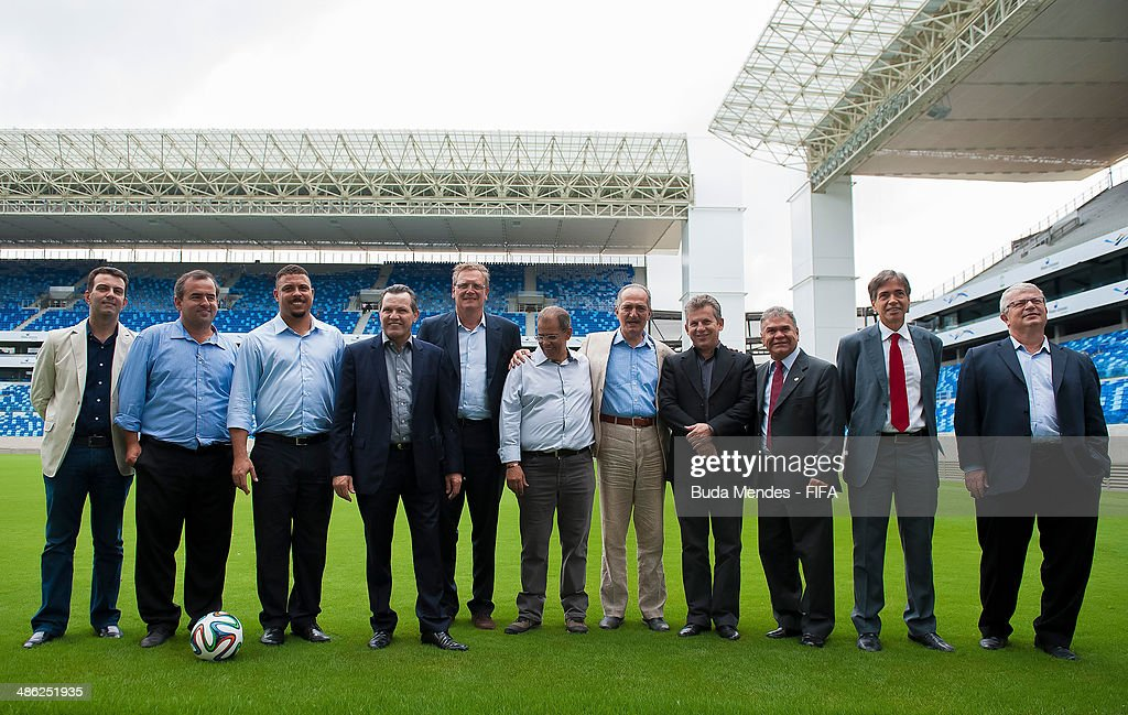 Secretary General Jerome Valcke (5L), Brazil Sports Minister Aldo Rebelo (5R), LOC Member Ronaldo Luis Nazario (3L), Governor of Mato Grosso Silval Barbosa (4L), Mayor of Cuiaba Mauro Mendes (4R) take a tour of the Arena Pantanal during the 2014 FIFA World Cup Host City Tour on April 23, 2014 in Cuiaba, Brazil