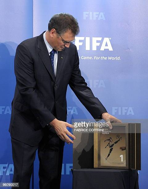 Secretary General Jerome Valcke displays the Korean World Cup bid books during an official handover ceremony at FIFA's headquarters on May 14 2010 in...