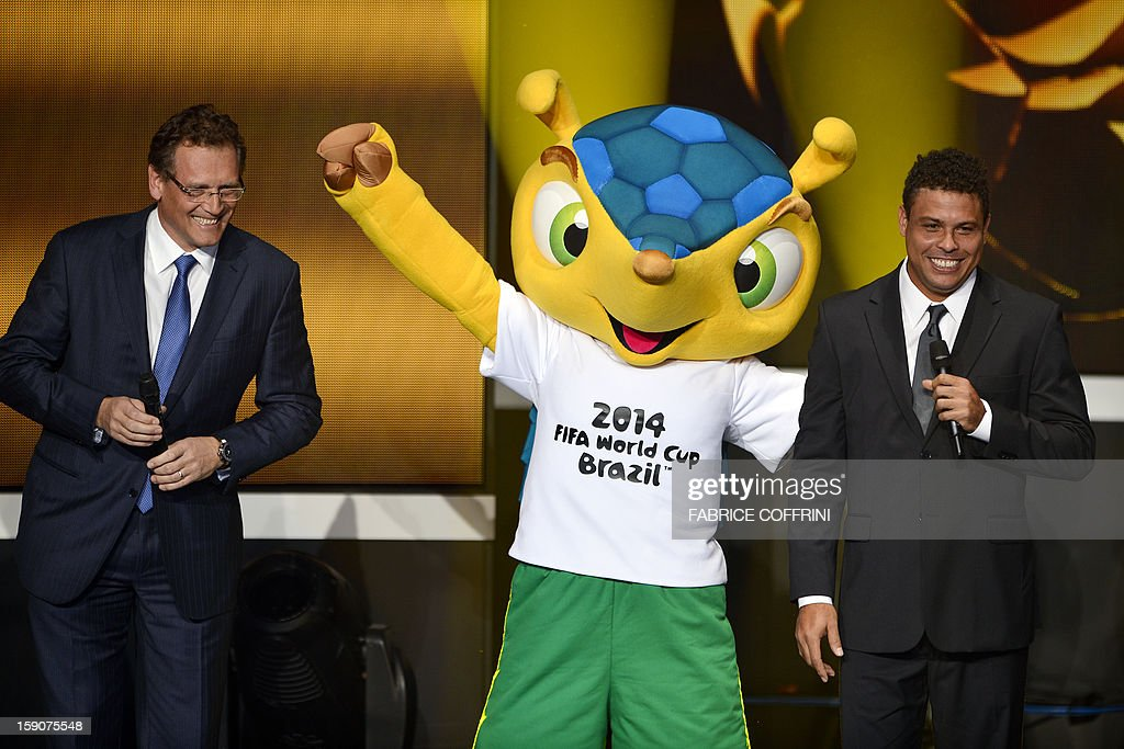 FIFA secretary general Jerome Valcke, Fuleco, the mascot for Brazil 2014 World cup and Brazilian former international Ronaldo joke on stage during the FIFA Ballon d'Or awards ceremony at the Kongresshaus in Zurich on January 7, 2013.