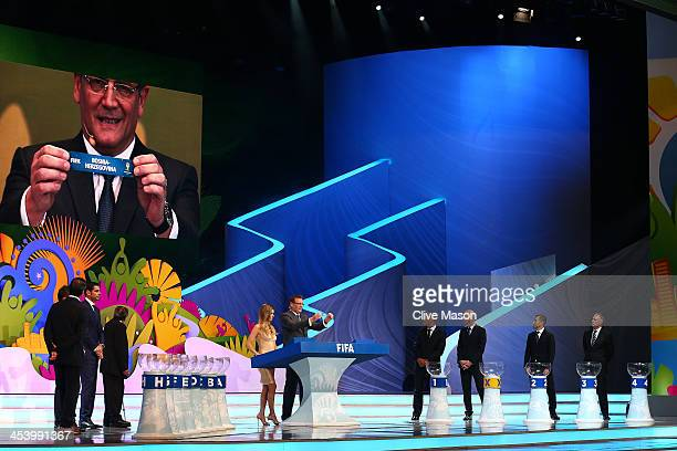 Secretary General Jerome Valcke holds up the name of BosniaHerzegovina during the Final Draw for the 2014 FIFA World Cup Brazil at Costa do Sauipe...
