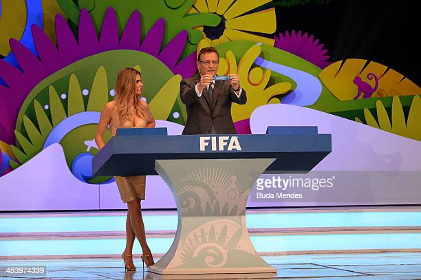 Secretary General Jerome Valcke holds up the name of Korea Republic during the Final Draw for the 2014 FIFA World Cup Brazil at Costa do Sauipe...