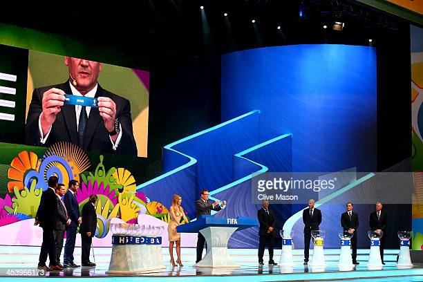 Secretary General Jerome Valcke holds up the name of Spain during the Final Draw for the 2014 FIFA World Cup Brazil at Costa do Sauipe Resort on...