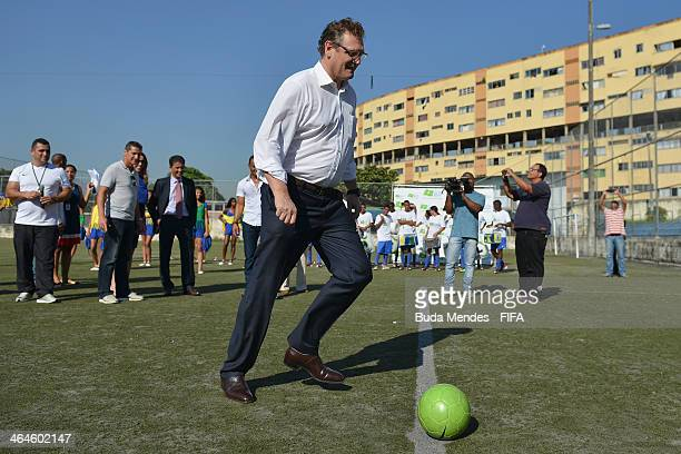 Secretary General Jerome Valcke kicks the ball at the football for hope supported organizacion Bola Pra Frente during the 2014 FIFA World Cup Host...