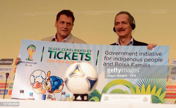 Secretary General Jerome Valcke presents on behalf of FIFA000 complimentary tickets for the 2014 FIFA World Cup to Brazilian Minister Aldo Rebelo...