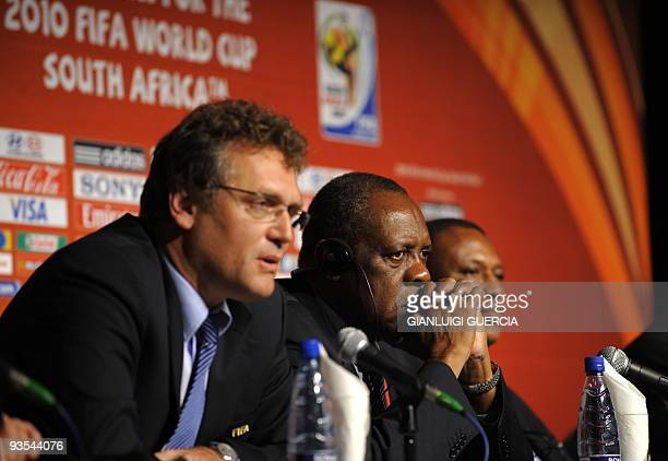 FIFA secretary general Jerome Valcke takes part in a press conference with local organising committee members Issa Hayatou and Irvin Khosa for the...