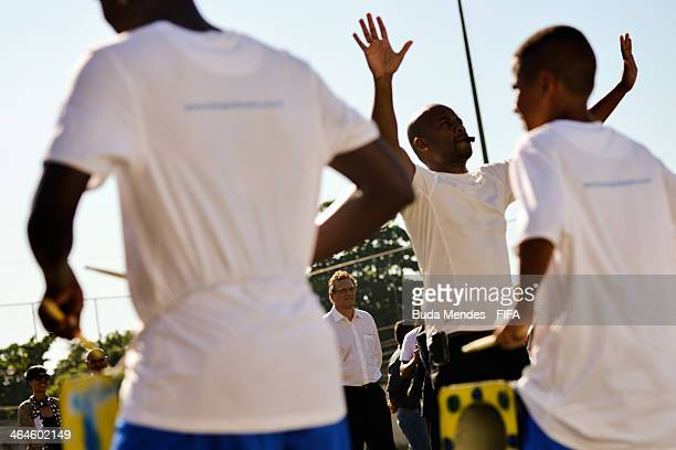 Secretary General Jerome Valcke watches a performance at the football for hope supported organizacion Bola Pra Frente during the 2014 FIFA World Cup...