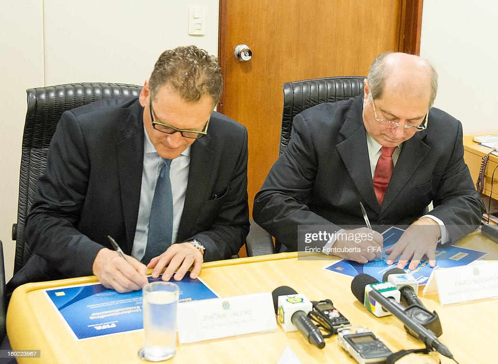 Secretary General Jerome Valckle (R) and Brazilian Communications Minister Paulo Bernardo Silva sign a Memorandum of Understanding prior to a press conference at the Ministry of Communications building during the 2014 FIFA World Cup Host City Tour on January 28, 2013 in Brasilia, Brazil.