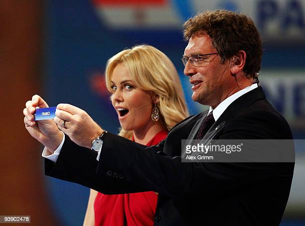 Secretary General Jérôme Valcke holds the name of France watched by Charlize Theron during the Final Draw for the FIFA World Cup 2010 December 4 2009...