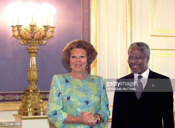 UN Secretary General Kofi Annan and Dutch Queen Beatrix pose for photographers at the palace Noordeinde in The Hague 18 May 1999 Annan called Tuesday...