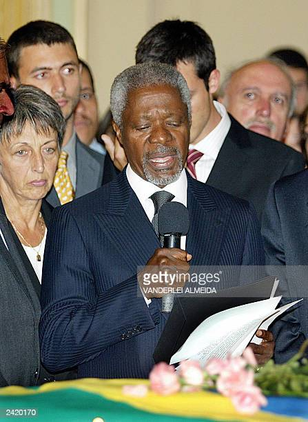 UN Secretary General Kofi Annan gives a speech as Brazilian born UN diplomat Sergio Vieira de Mello's widow Annie listens during a remembrance...