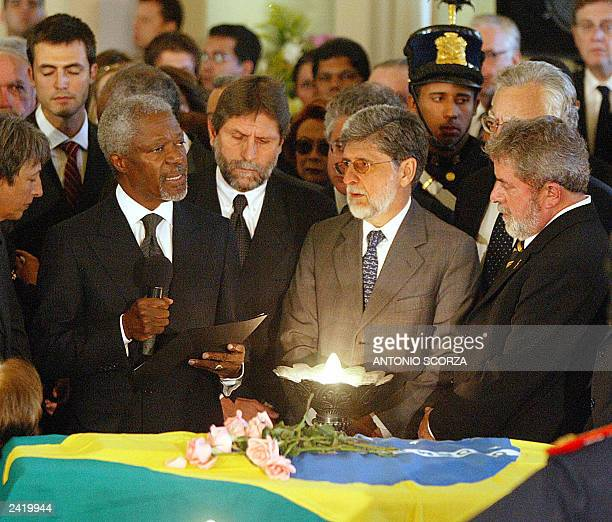 UN Secretary General Kofi Annan gives a speech in front of the coffin of Brazilian diplomat Sergio Vieira de Mello 23 August 2003 while Brazilian...