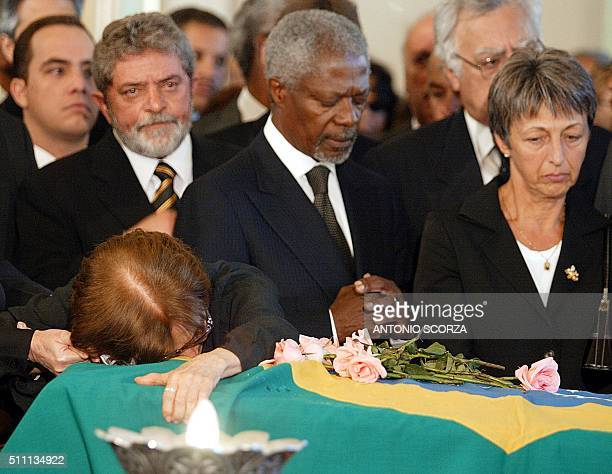 UN Secretary General Kofi Annan prays while Gilda Vieira de Mello mother of Brazilian diplomat Sergio Vieira de Mello embraces his coffin accompanied...