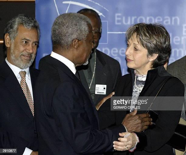 Secretary General Kofi Annan speaks to Annie de Mello the widow of Annan's late special representative to Iraq Sergio Viera de Mello as East Timor...