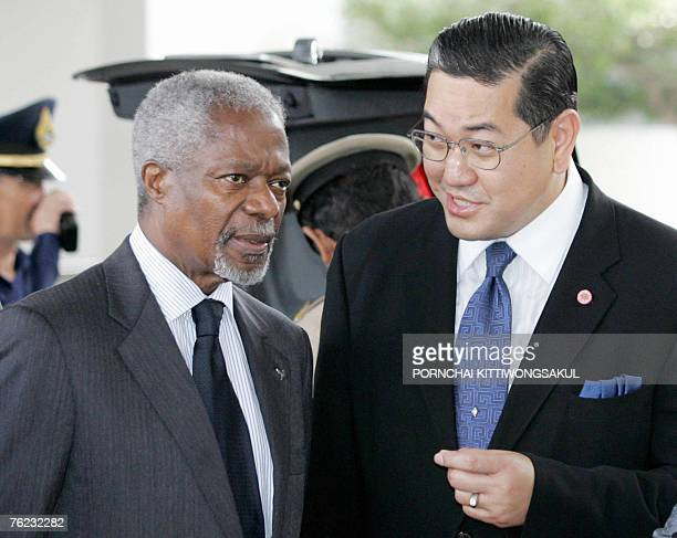 UN Secretary General Kofi Annan talks with Thai deputy Prime Minister Surakiart Sathirathai at the International airport in Bangkok 27 May 2006 Annan...