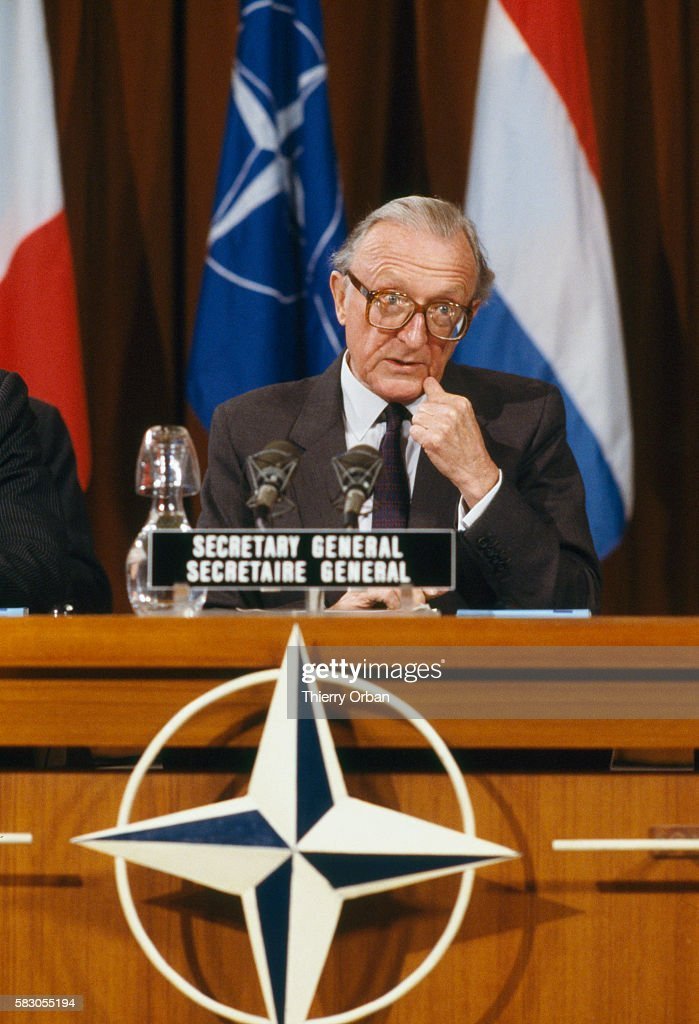 Secretary General Lord Peter Carrington takes part in a NATO press conference in Brussels.