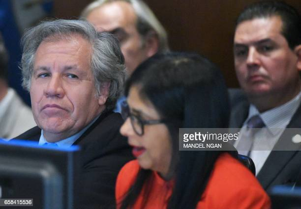 OAS Secretary General Luis Almagro watches as Venezuela's Foreign Minister Delcy Rodríguez speaks during an address to the Organization of American...