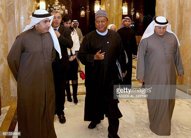 OPEC secretary general Mohammad Sanusi Barkindo arrives to hold a joint press conference with the Kuwaiti oil minister in Kuwait City on January 9...