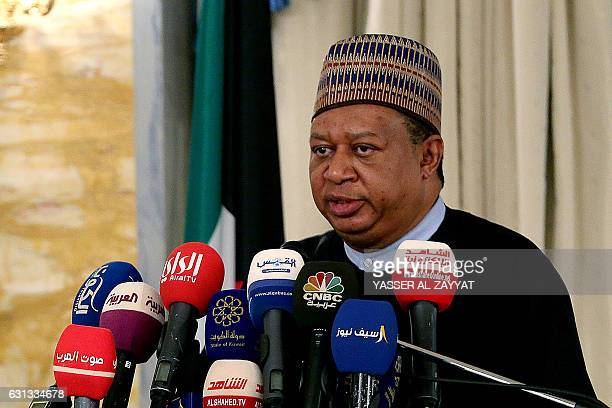 OPEC secretary general Mohammad Sanusi Barkindo speaks during a joint press conference with the Kuwaiti oil minister in Kuwait City on January 9 2017...