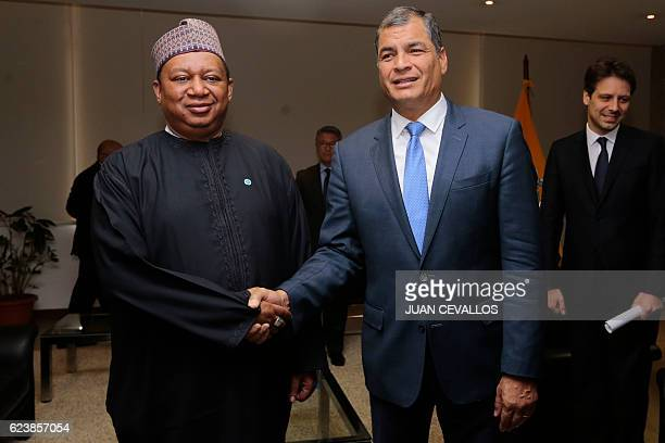 Secretary General Mohammed Barkindo and Ecuador's President Rafael Correa pose for pictures during a meeting at the Sports Ministry in Quito on...