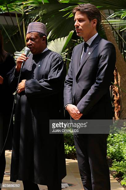Secretary General Mohammed Barkindo speaks to the press next to Ecuador's Foreign Minister Guillaume Long after holding a meeting with Ecuador's...