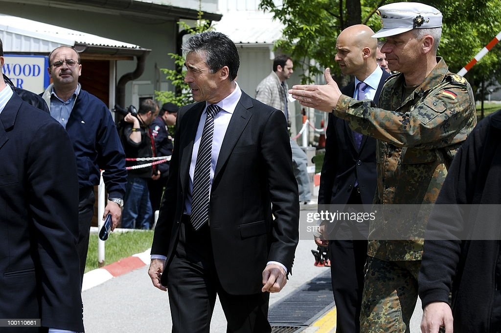 Secretary General Mr Anders Fogh Rasmussen (C), flanked by KFOR Commander General Markus Bentler (R), leaves after a press conference at the KFOR headquarters in Pristina on May 21, 2010.
