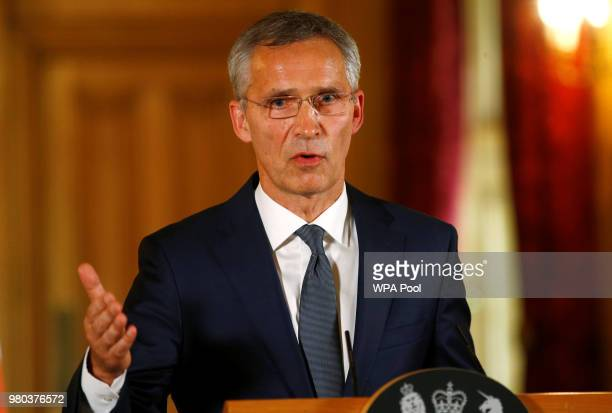 Secretary General of NATO Jens Stoltenberg speaks during a press conference with British Prime Minister Theresa May is seen during inside Number 10...