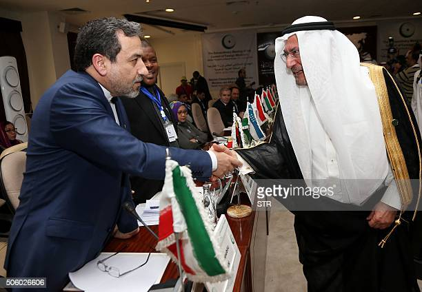 Secretary General of Organisation of Islamic Cooperation Saudi Iyad Madani shakes hands with Iran's Deputy Foreign Minister Abbas Araghchi during an...