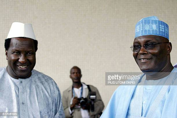 Secretary General of the Africa Union Alpha Omar Konare discusses with Nigerian Vice President Abubakar Atiku Monday 23 August 2004 shortly on his...